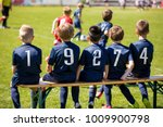 kids sport team sitting on a... | Shutterstock . vector #1009900798