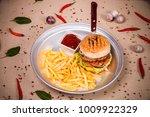hamburger and fried potato at...