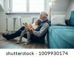 elderly man holding his...   Shutterstock . vector #1009930174