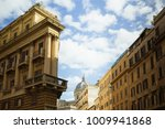 """Small photo of Look up view from roman yellow buildings in a sunny day. On the facade of the building: """"placed so that the world might obtain government"""""""