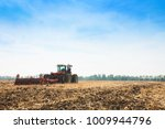 modern tractor in the field... | Shutterstock . vector #1009944796