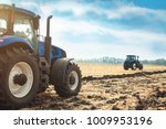 two tractors working in a field ... | Shutterstock . vector #1009953196