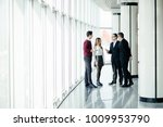 the business people walk in the ... | Shutterstock . vector #1009953790