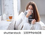 cold and flu. sick woman caught ... | Shutterstock . vector #1009964608