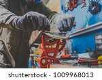 a male worker in a ski service... | Shutterstock . vector #1009968013