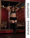 Small photo of Female striptease on the pole in a nightclub