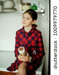adorable kid girl in plaid red... | Shutterstock . vector #1009979770