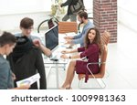 group of designers working in a ... | Shutterstock . vector #1009981363