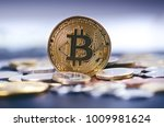 Stock photo golden bitcoin coins on a dark background with euro coins virtual currency crypto currency new 1009981624