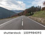 european country road. turn... | Shutterstock . vector #1009984093