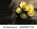 still life image of slices over ... | Shutterstock . vector #1009987720
