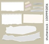 ripped note paper sheets and... | Shutterstock .eps vector #1009992856