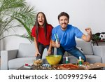 young couple sport fans... | Shutterstock . vector #1009992964