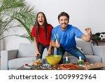 young couple sport fans... | Shutterstock . vector #1009992964