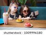 two cute little girls making...   Shutterstock . vector #1009996180