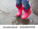 the girl in pink boots jumping... | Shutterstock . vector #1010004538