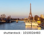 sunset on eiffel tower and pont ... | Shutterstock . vector #1010026483