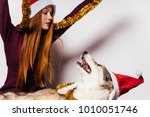 woman in a christmas hat... | Shutterstock . vector #1010051746