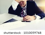 businessman feel sad... | Shutterstock . vector #1010059768