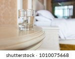 there is a glass of water on... | Shutterstock . vector #1010075668