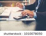 a businessman using a... | Shutterstock . vector #1010078050