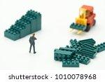 miniature people businessmen... | Shutterstock . vector #1010078968