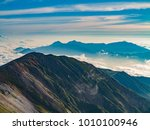 clouds and mountains visible to ... | Shutterstock . vector #1010100946