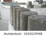 arrange wet cylinder  concrete... | Shutterstock . vector #1010119348