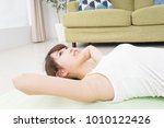 woman doing yoga | Shutterstock . vector #1010122426