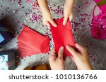 close up hands of parent giving ... | Shutterstock . vector #1010136766
