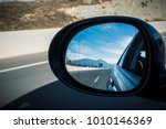 left mirror car on a highway on ... | Shutterstock . vector #1010146369