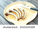 barbeque bones on wooden dish... | Shutterstock . vector #1010165200