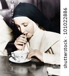 nun sipping tea out of a teacup ... | Shutterstock . vector #101022886