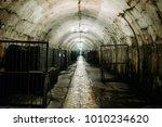 stacks of bottles in old wine...   Shutterstock . vector #1010234620