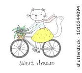 cat with a bicycle and flowers. ... | Shutterstock .eps vector #1010244094