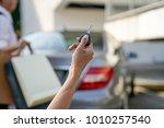 women's hand presses on the... | Shutterstock . vector #1010257540
