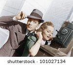 man and woman listening on an... | Shutterstock . vector #101027134