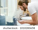 man washing face. young male... | Shutterstock . vector #1010283658