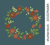 floral embroidery wreath with... | Shutterstock .eps vector #1010296684