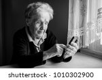 elderly woman takes on... | Shutterstock . vector #1010302900