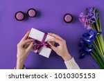cropped image of girl opening... | Shutterstock . vector #1010305153