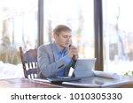 businessman making video call... | Shutterstock . vector #1010305330