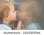 cute toddler leaning to the... | Shutterstock . vector #1010305366