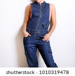fashion. young woman in jeans... | Shutterstock . vector #1010319478