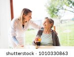 health visitor and a senior... | Shutterstock . vector #1010330863