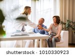 female doctor talking to a... | Shutterstock . vector #1010330923