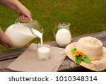milk is poured into a glass...   Shutterstock . vector #1010348314