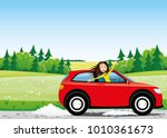 cheerful woman in a red car on... | Shutterstock .eps vector #1010361673