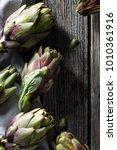 artichoke on wood background   Shutterstock . vector #1010361916
