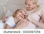 daughter and pregnant mother... | Shutterstock . vector #1010367256